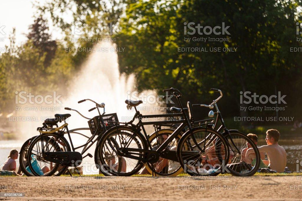 Vondelpark Lake Fountain and Bicycles stock photo