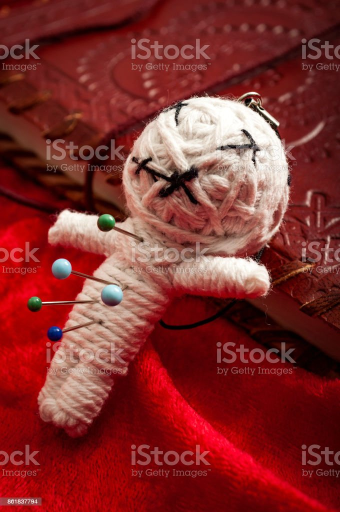 Voodoo doll on a book stock photo