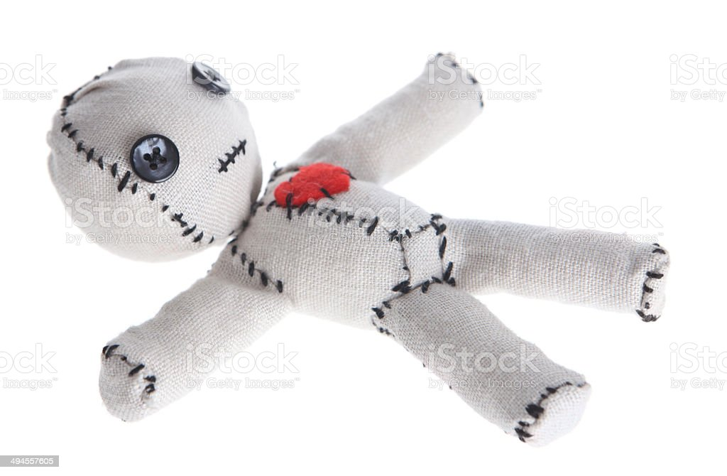 Voodoo Doll on White Background stock photo