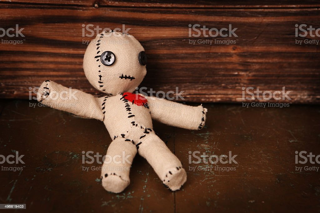 Voodoo Doll on Wood stock photo