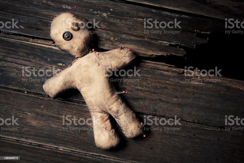 voodoo doll photo of creepy voodoo doll on wooden floor Art Stock Photo
