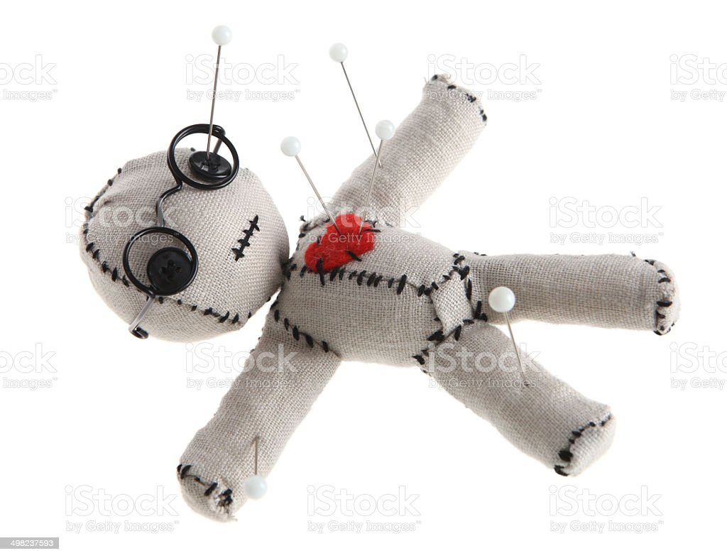 Voodoo Doll with Pins Isolated on White Background stock photo