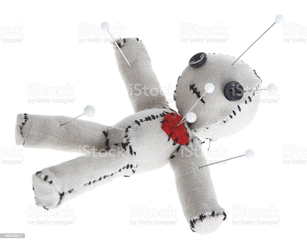 Voodoo Doll with Pins on White Background stock photo