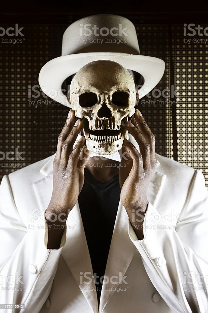 Voodoo Man Holding Skull In Front Of Face. stock photo