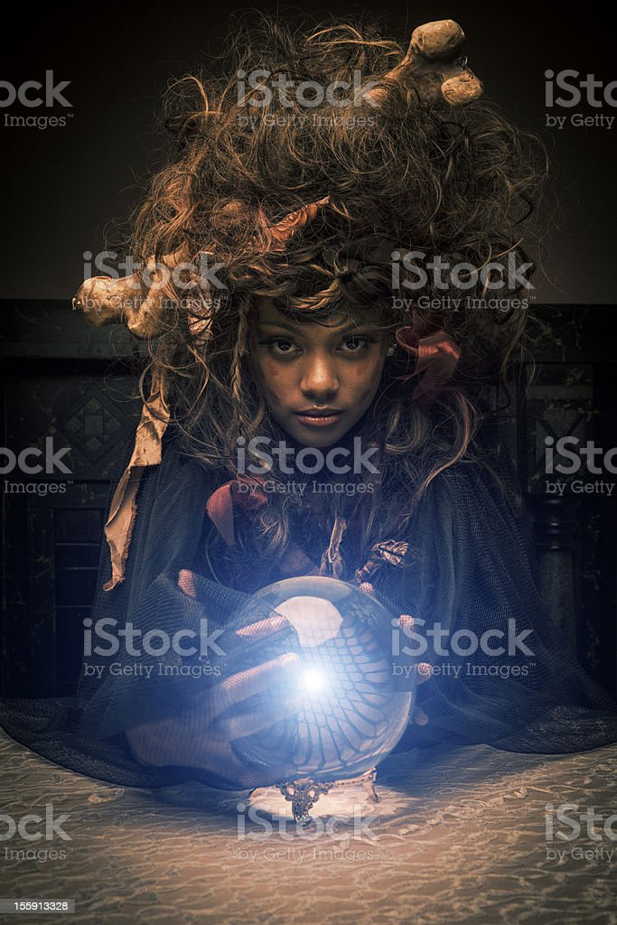 Voodoo Priestess with magic ball stock photo