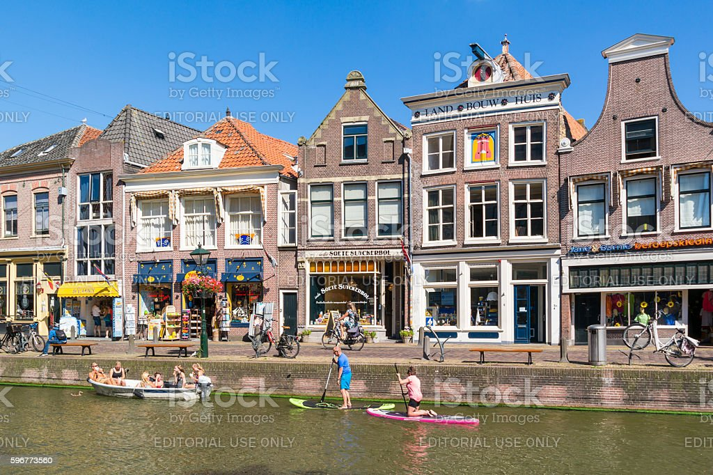 Voordam canal with paddle surfers, Alkmaar, Netherlands stock photo