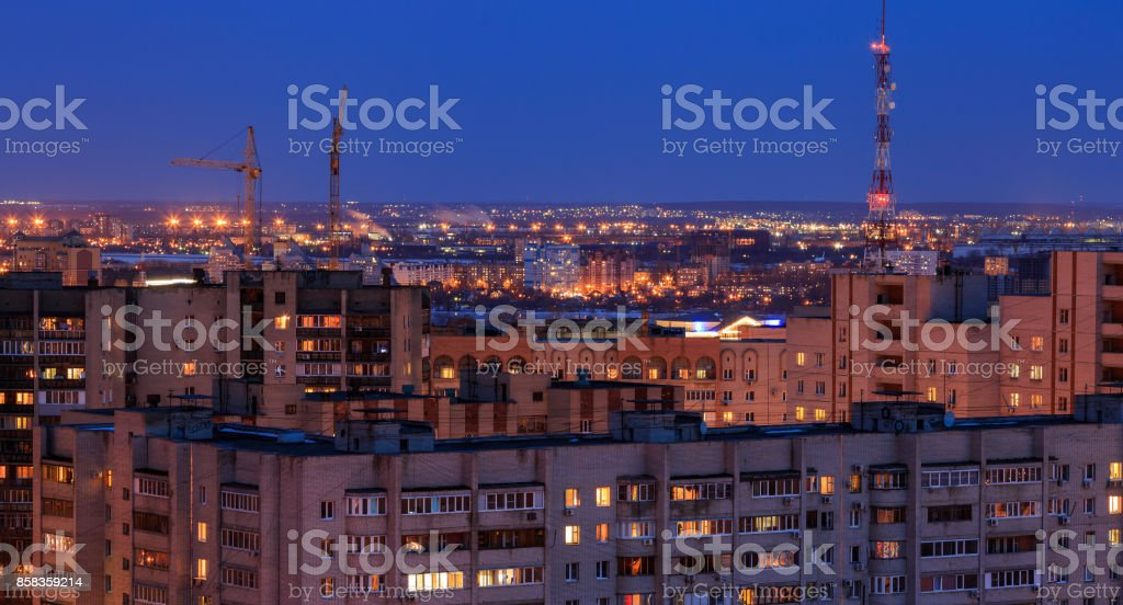 Voronezh evening cityscape from rooftop. Sleeping quarters, House, city lights, stock photo