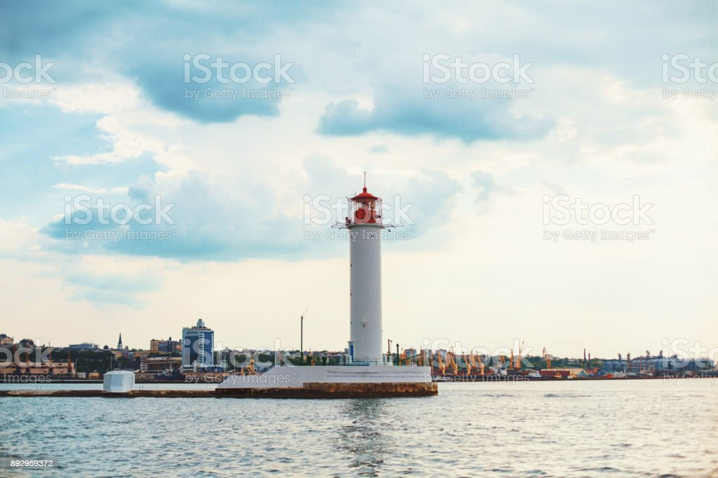 Vorontsov Lighthouse in the gulf of Odessa, Ukraine. Beautiful sunny day landscape with sea skyline. Amazing city panorama with blue water and beacon, pharos, seamark stock photo