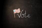 TEXT Vote against black backdrop - Illustration
