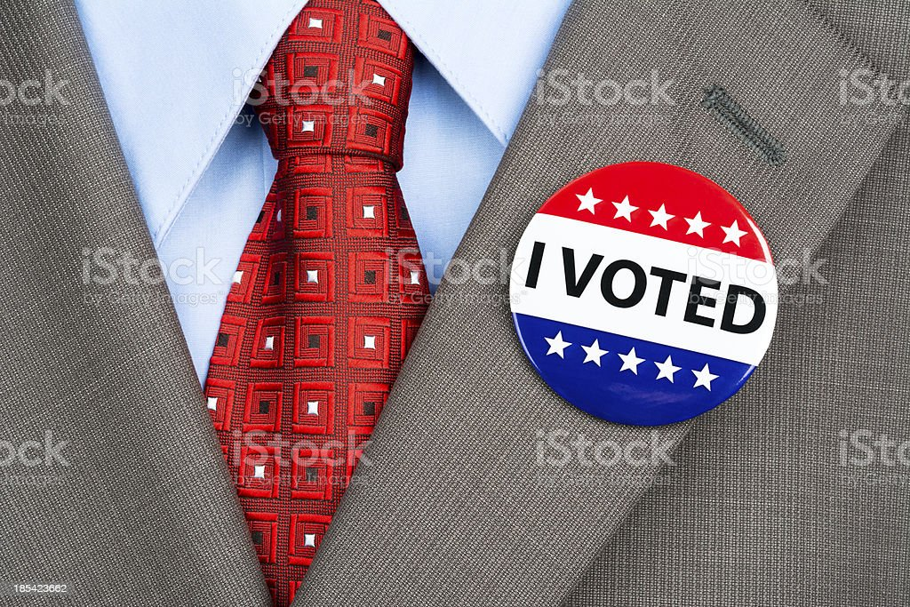 Vote badge on tan suit stock photo