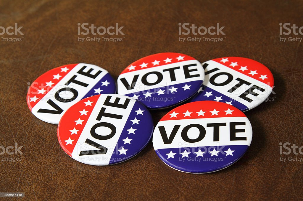 Vote buttons or pins on a dark background stock photo