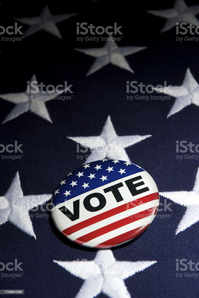 Vote Election Pin Stars and Stripes on American Flag royalty-free stock photo