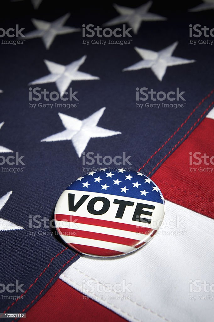Vote Election Pin Stars and Stripes on American Flag stock photo