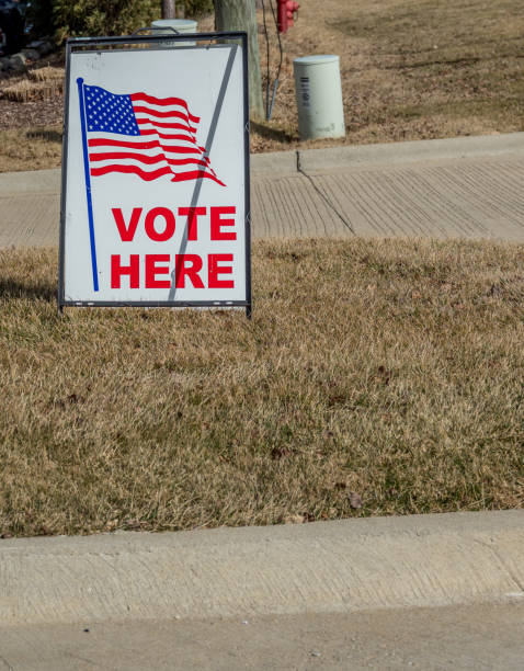 vote here - vote sign stock photos and pictures