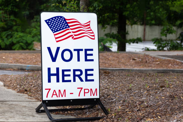 vote here sign outside an election site. - polling place stock pictures, royalty-free photos & images