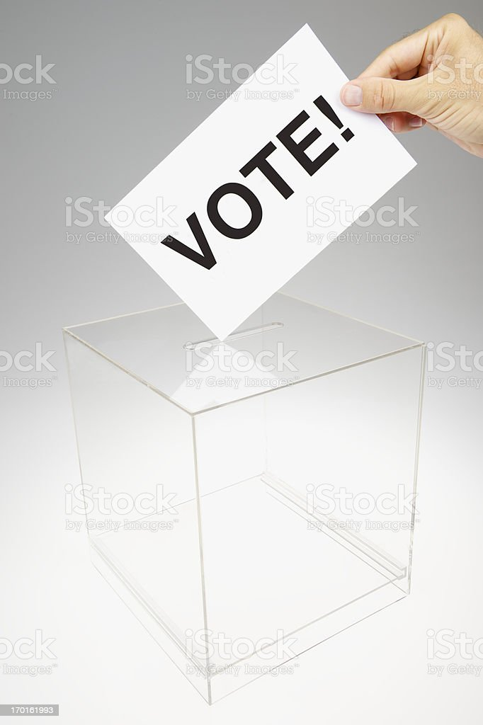 Vote! Message on Voting Card in Ballot Box stock photo