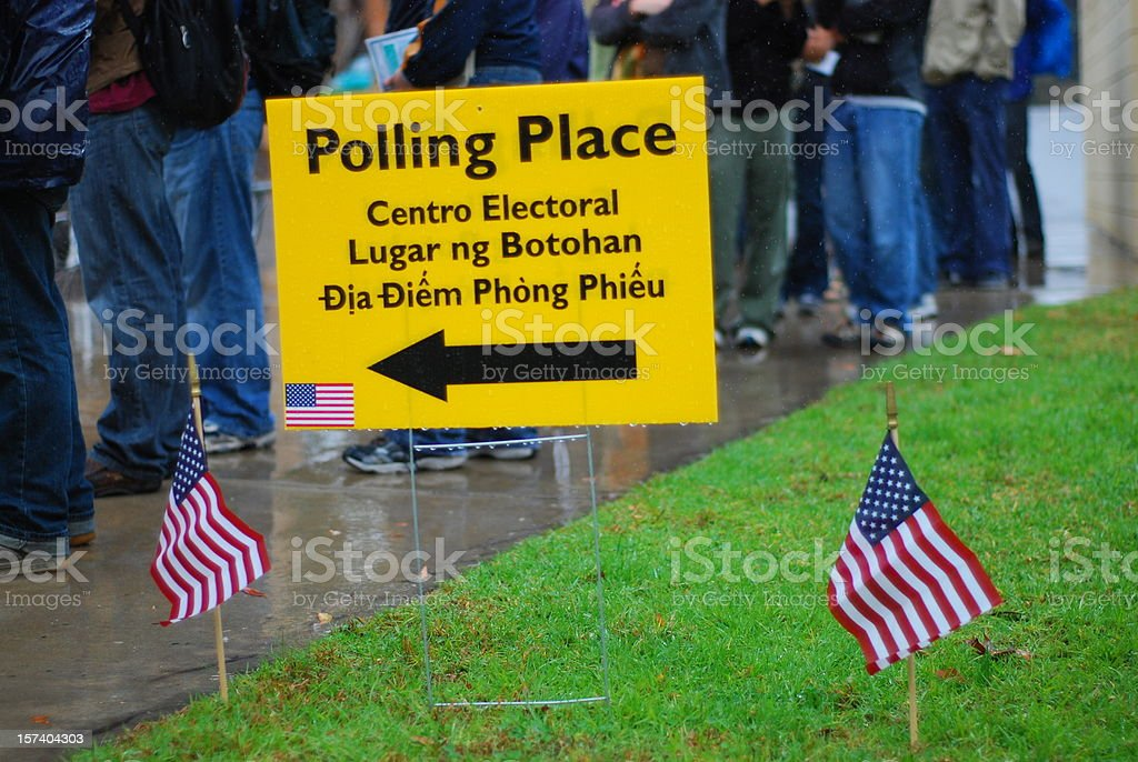Vote! Voters waiting in rain at polling place stock photo