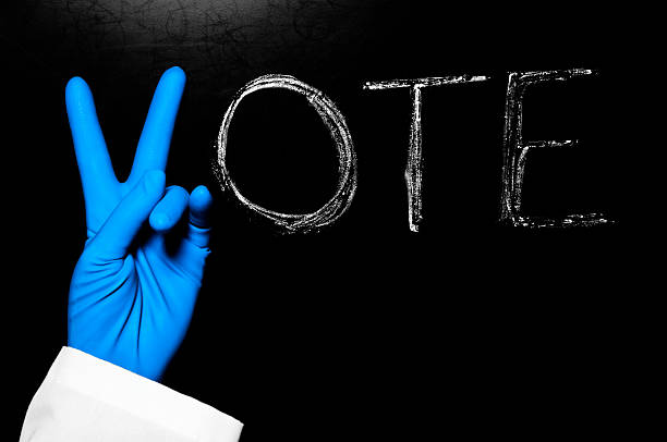 vote with blue latex glove - kellyjhall stock pictures, royalty-free photos & images