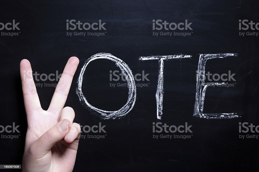Vote with young adult hand stock photo