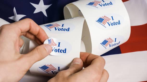 ben abd bayrağı ile etiket oy - vote stok fotoğraflar ve resimler