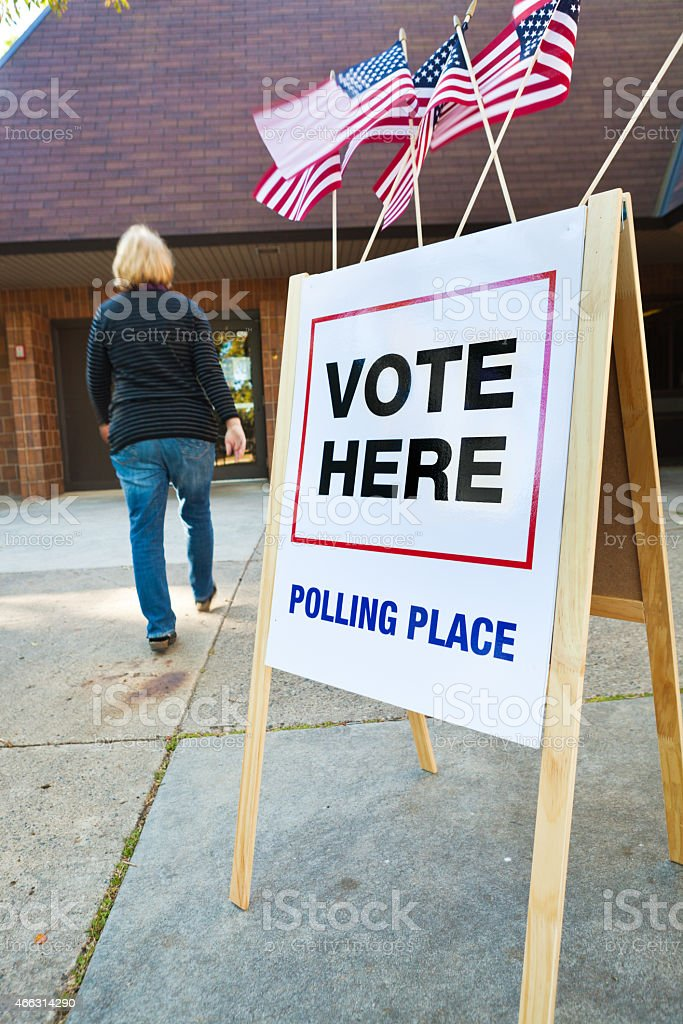 Voter Entering US Polling Place for Voting Vertical stock photo