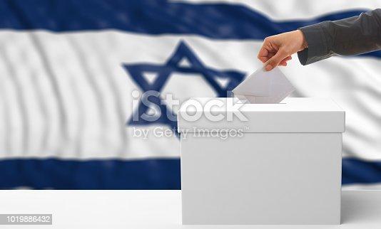 istock Voter on an Israel flag background. 3d illustration 1019886432