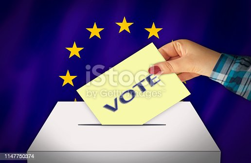 1126684642 istock photo Voter on an waiving European Union flag background. 1147750374
