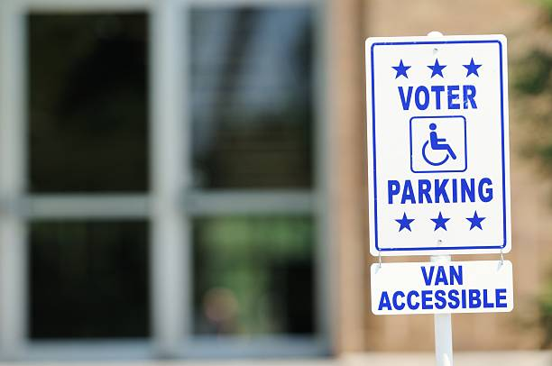 voter parking van accessible sign - vote sign stock photos and pictures
