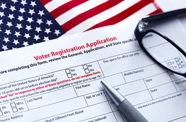 Voter Registration Application Voter registration application with flag of United States of America register stock pictures, royalty-free photos & images
