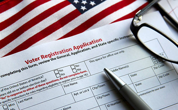 Voter Registration Voter registration form with flag of United States of America register stock pictures, royalty-free photos & images