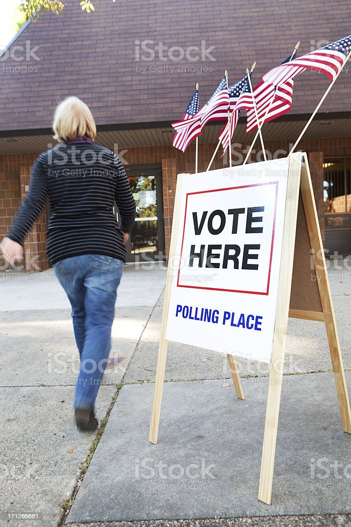USA Voter Voting in Election Polling Place Station royalty-free stock photo