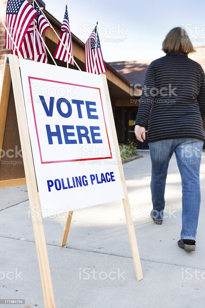 Voter Voting in Polling Place USA royalty-free stock photo