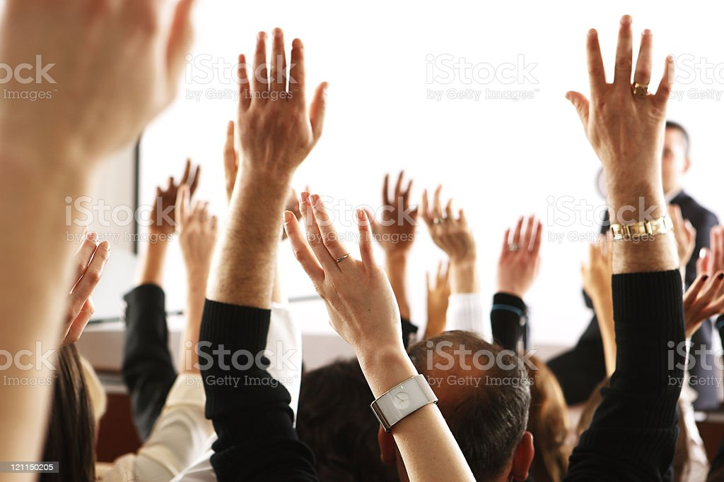 Voting audience, business spectators or students raising hands in seminar stock photo