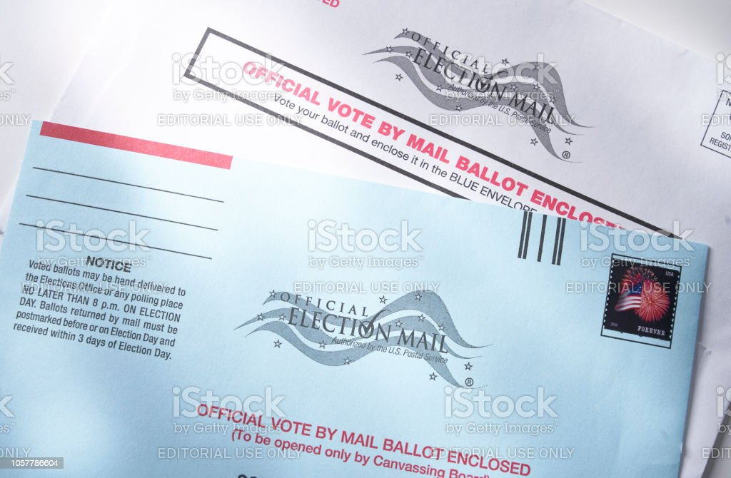 Voting ballot: Absentee voting by mail with ballot envelope stock photo