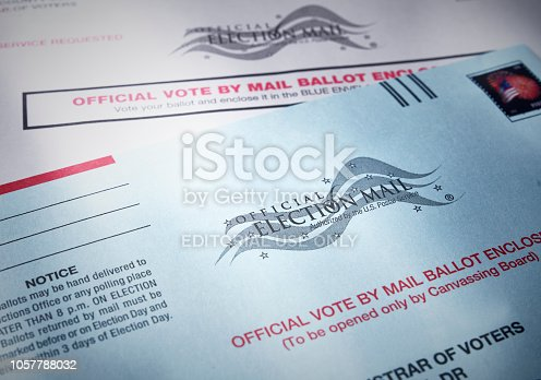 THE SEA RANCH, CALIFORNIA - October 21, 2018: Voting ballot: Absentee voting by mail with ballot envelope. Absentee voting is voting-by-mail and allows voters who cannot visit the polls on Election Day, to cast their ballot by the US mail.