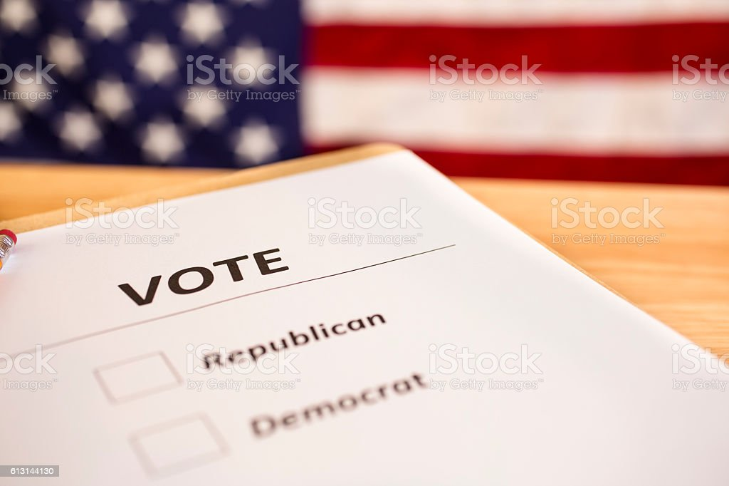 Voting ballot for political parties with USA flag. stock photo