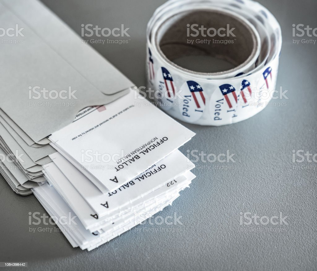 Voting ballot with 'I Voted' sticker and envelopes for casting votes in elections in the USA stock photo