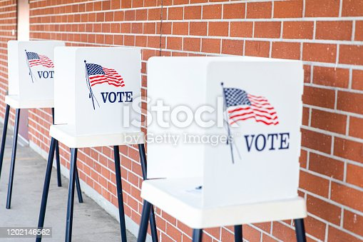 1001757106 istock photo Voting Booths with no people 1202146562