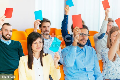 933450738 istock photo Voting for candidates in assembly 613784236