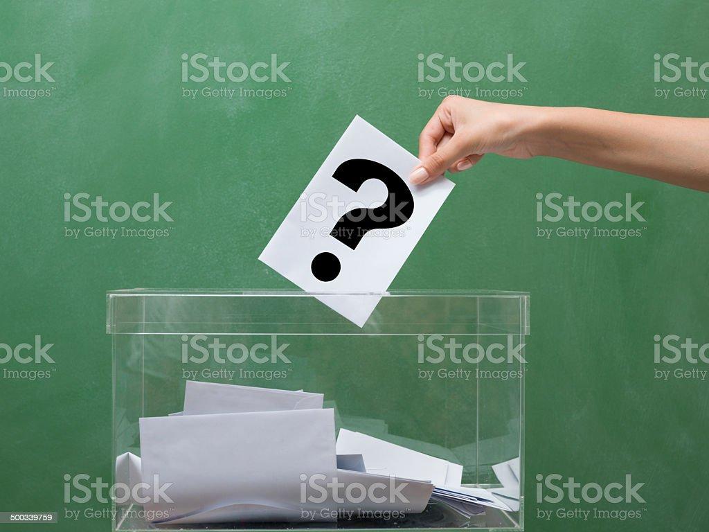 Voting for election, transparent ballot box Voting for election in front of black blackboard Activity Stock Photo