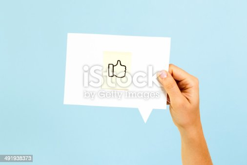 istock Voting hand on speech bubble 491938373