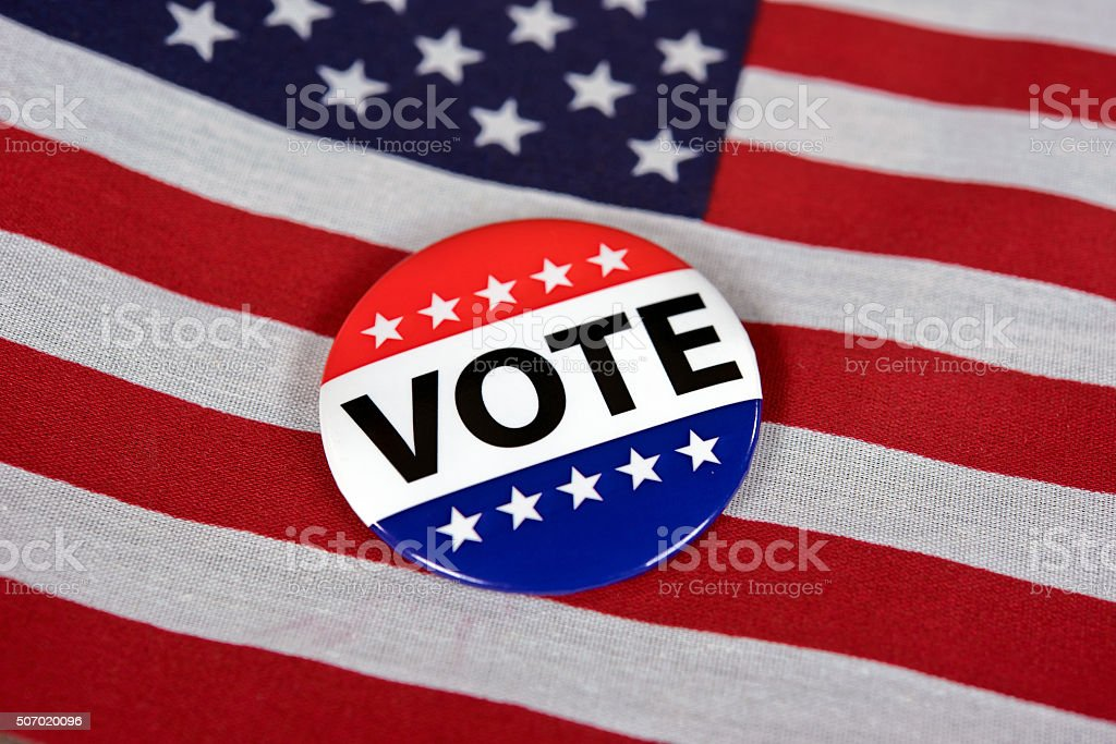 voting pin on American flag stock photo