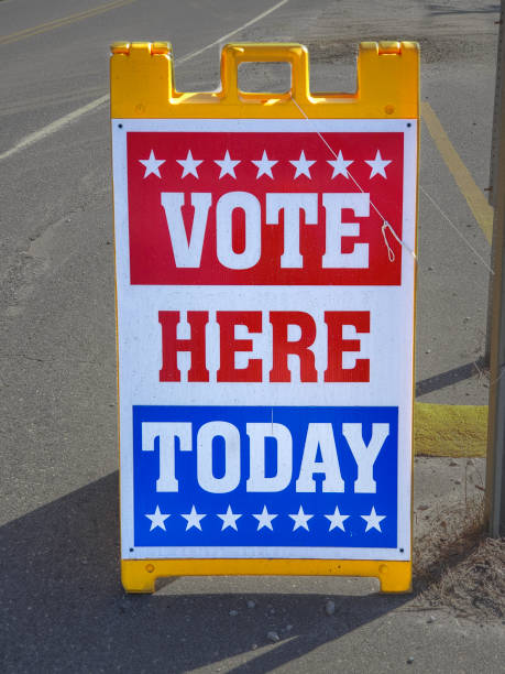 Voting Sign at Polling Place - Democracy - Election stock photo