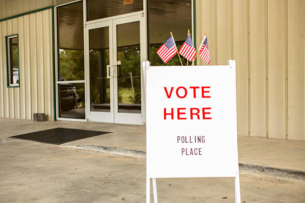 voting sign outside local polling station during american november elections. - vote sign stock photos and pictures