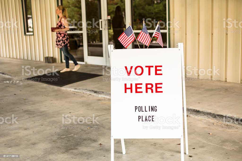 Voting sign outside local polling station during American November elections. stock photo