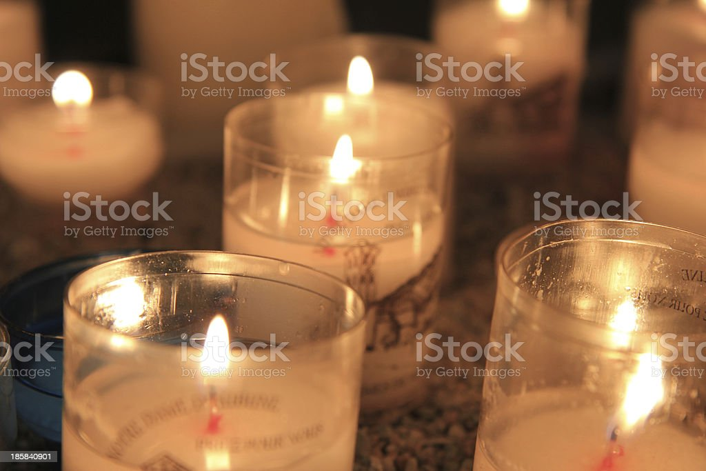 Votive candles in a church stock photo