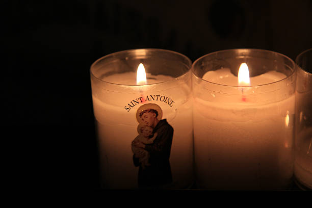 Votive candles in a church Votive candles, burning in a French Roman Catholic church st. anthony of padua stock pictures, royalty-free photos & images