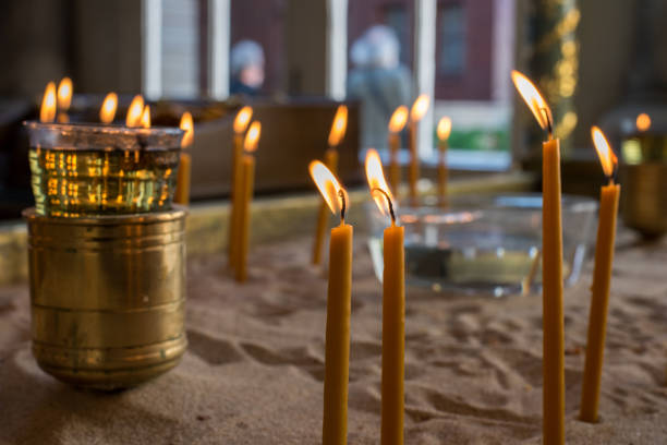 Votive candles in church stock photo