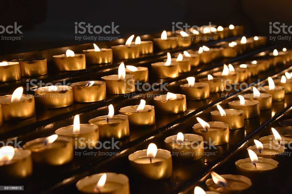 Votive Candles in Rows stock photo