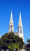 Vienna, Austria - September 17, 2012: The Votive Church, the typical form of a Gothic cathedral, located on the Ringstrasse in Vienna, Austria.